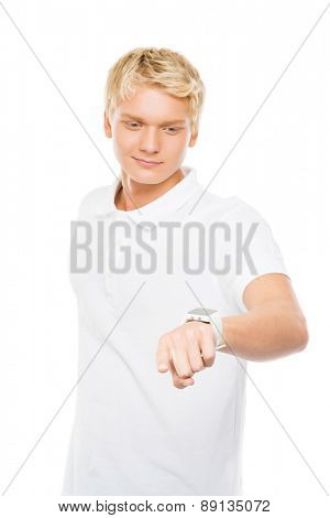 Young and handsome teenage boy pushing an imaginary  and invisible button isolated on white