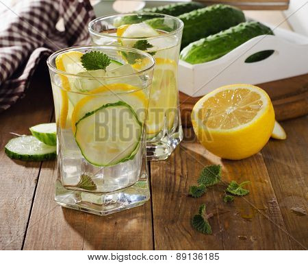 Fresh Water With Lemon, Mint  And Cucumber  On  Wooden Background.