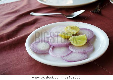 Lemon And Onions On Table