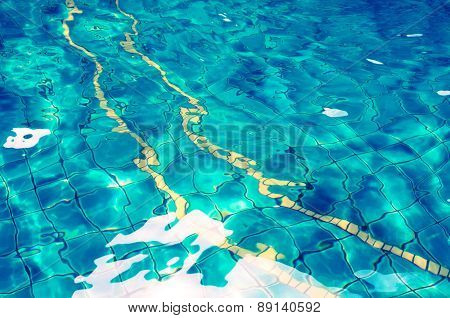Background of rippled water in swimming pool