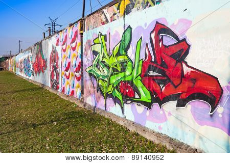Colorful Graffiti Painted Over Concrete Garage Walls
