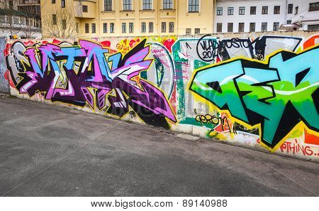 Colorful Chaotic Graffiti Text Painted On Concrete Fence