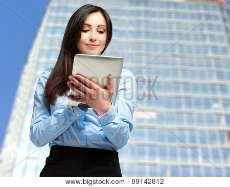 Portrait of a woman using a digital tablet