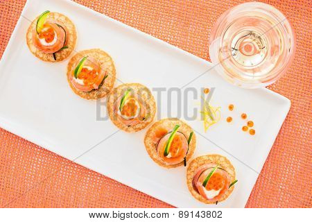 Smoked Salmon And Caviar Appetizer With Cream Fresh And Cucumbers On Blini, Top View