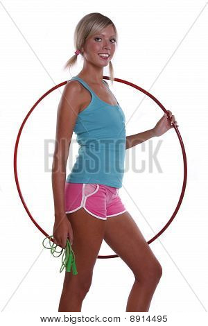 Woman with hula hoop and jump rope.
