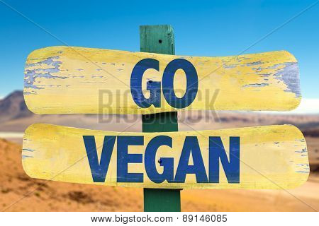 Go Vegan sign with desert background