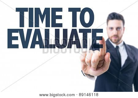 Business man pointing the text: Time to Evaluate