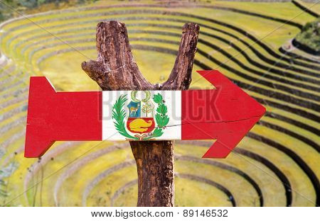 Peru Flag wooden sign with Pisac background - Inca ruins in the sacred valley