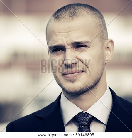 Portrait of young handsome businessman outdoor