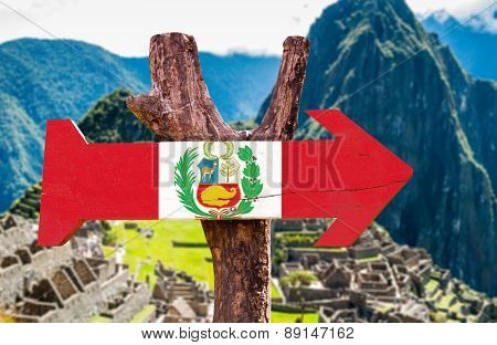 Peru Flag wooden sign with Machu Picchu background