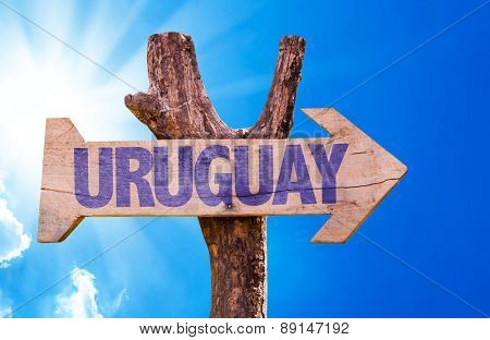 Uruguay wooden sign with sky background