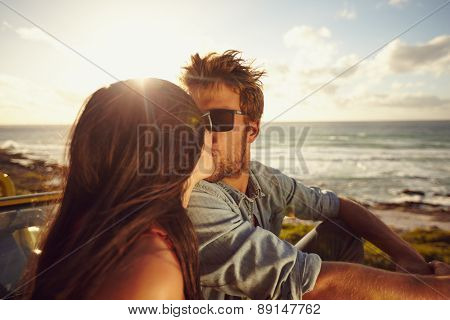 Affectionate Young Couple Kissing At The Beach