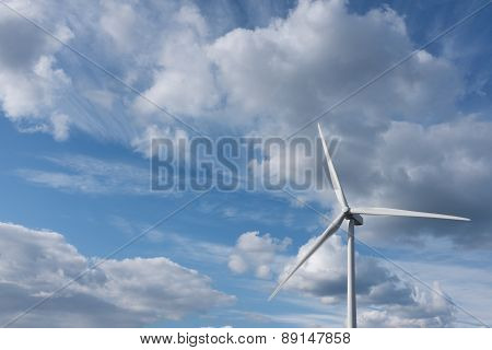 Wind Turbine Against Dramatic Cloudy Sky