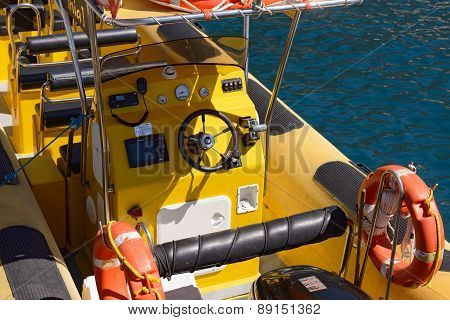 Yellow Cockpit Of Pleasure Boat In Bright Sunlight.