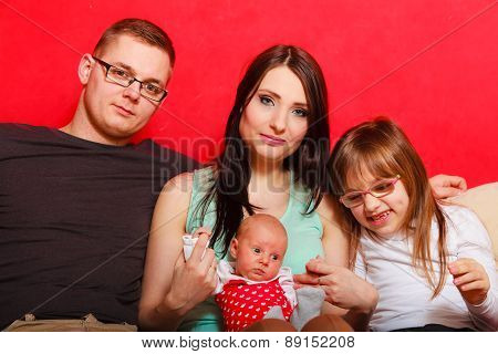 Family With Newborn Baby Girl Portrait