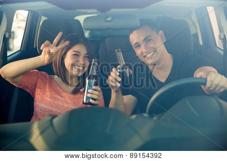 Irresponsible Couple In A Car