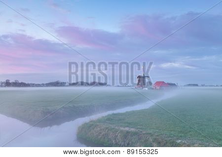 Dutch Windmill At Misty Sunrise