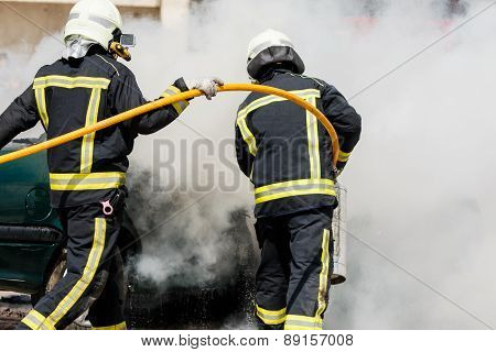 Two firefighters working