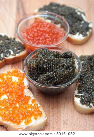 Black and red caviar in glass container