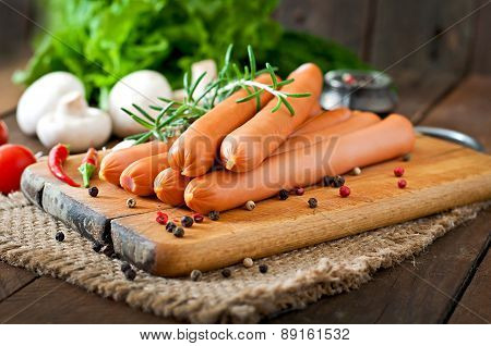 Sausage on a wooden background