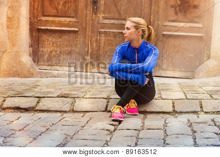 Young female runner in old city center