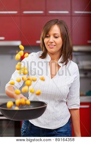 Young Woman Frying Potatoes