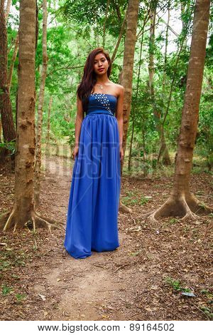 Beautiful Latin Woman With Blue Dress At Forest