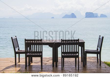 Dining Table Prepared For Two On White Sand Beach