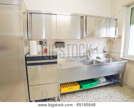 Industrial Kitchen With Refrigerator, Dishwasher And Sink All Stainless Steel