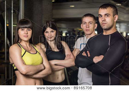 Group Of Athletes Standing In The Gym