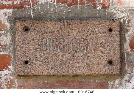 Old Brick Wall With A Blank Marble Slab
