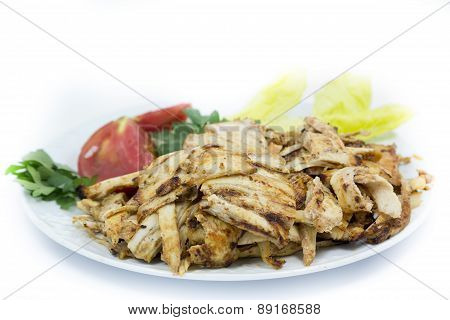 Turkish doner chicken on plate isolated on white background