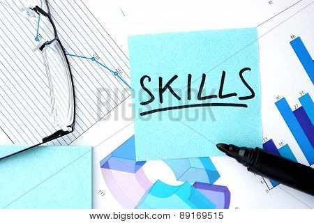 Papers with graphs and Skills concept.