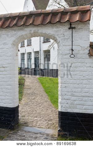 Medieval white houses of the beguinage of the famous city of Bruges in Flanders, Belgium