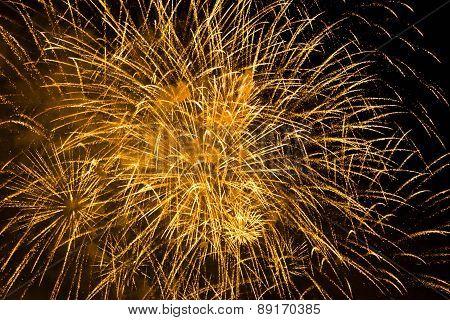 Orange Fireworks In The Night Sky