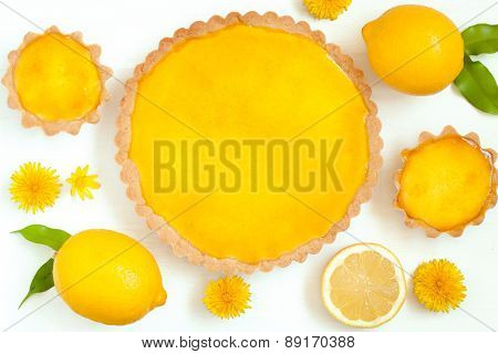 Tasty homemade backed lemon tart pie dessert with narcissus flowers