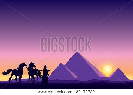 Egypt Great Pyramids With Bedouin And Horses Silhouettes On Sunset Background