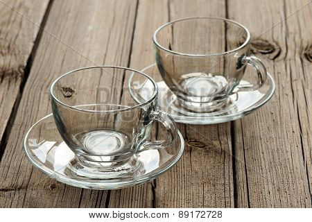 Two Empty Glass Teacups On Wooden Background
