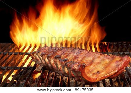 Grilled Ribs And Flaming Hot Grill On The Background.