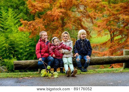 Laughing kids sitting together
