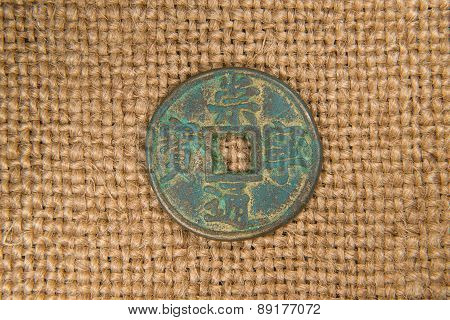 Ancient Chinese Bronze Coin On Old Cloth
