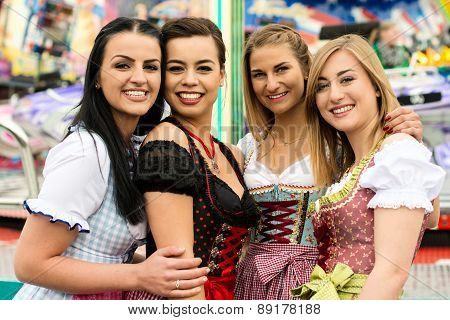 4 gorgeous young women at German funfair