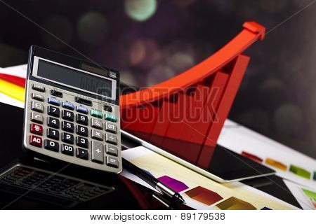 Financial graph on tablet with calculator
