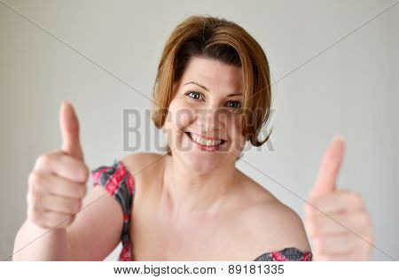Portrait Of Woman Showing Gesture That Everything Is Fine