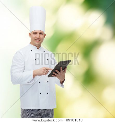 cooking, profession and people concept - happy male chef cook holding tablet pc computer over green background
