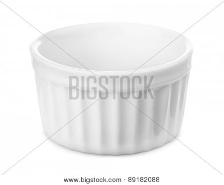 Small glazed ceramic ramekin isolated on white