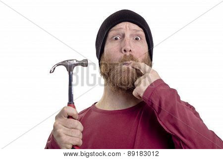 man hits finger with hammer isolated on white background