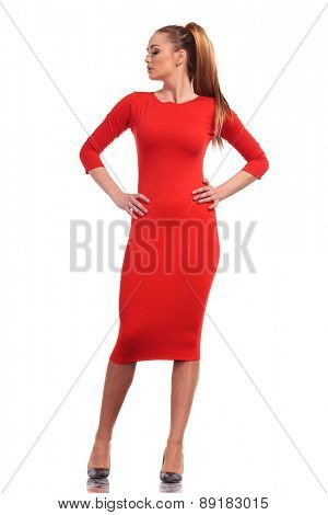 Full length picture of a sexy young business woman posing with her hands on the waist on isolated background.