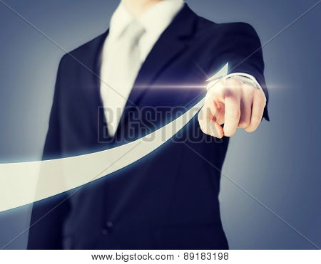 business concept - businessman hand showing raising arrow on virtual screen