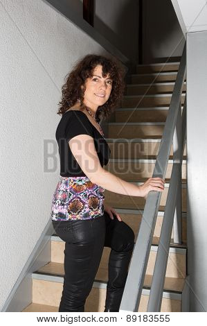 Happy Woman Climbing Stairs